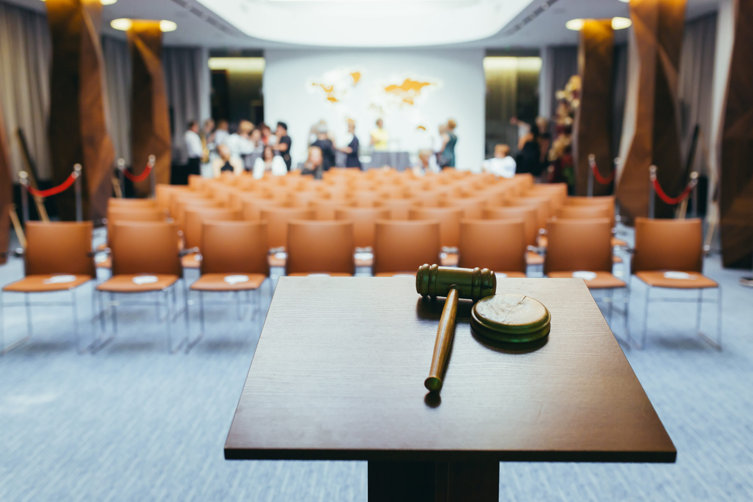 Hammer for the auction, on the background of the conference hall