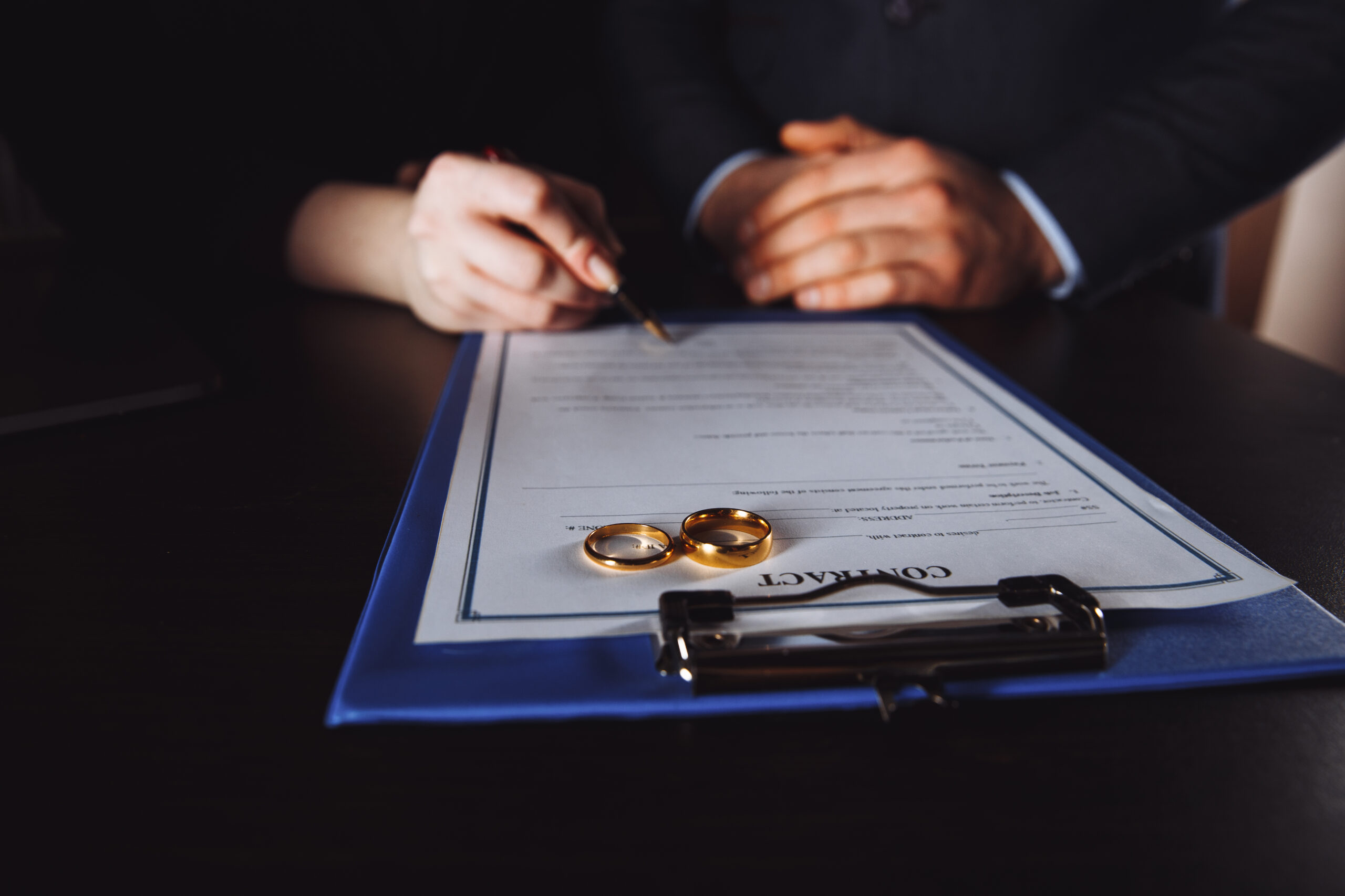 Marriage contract sign concept. Man and woman signing documents