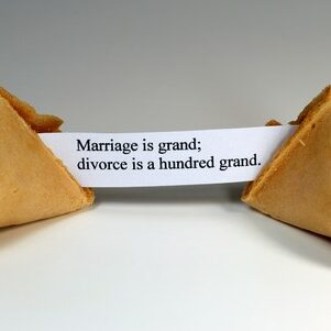 4367422 - fortune cookie with the expression: marriage is grand, divorce is a hundred grand.